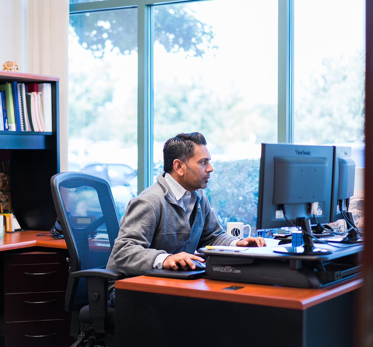 meyer employee at his desk reading his computer